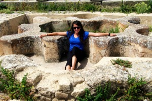 Sitting in an ancient hot tub while exploring the ruins of Volubilis.