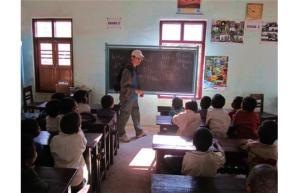 Peter McSheffrey teaches a school group in Burma.